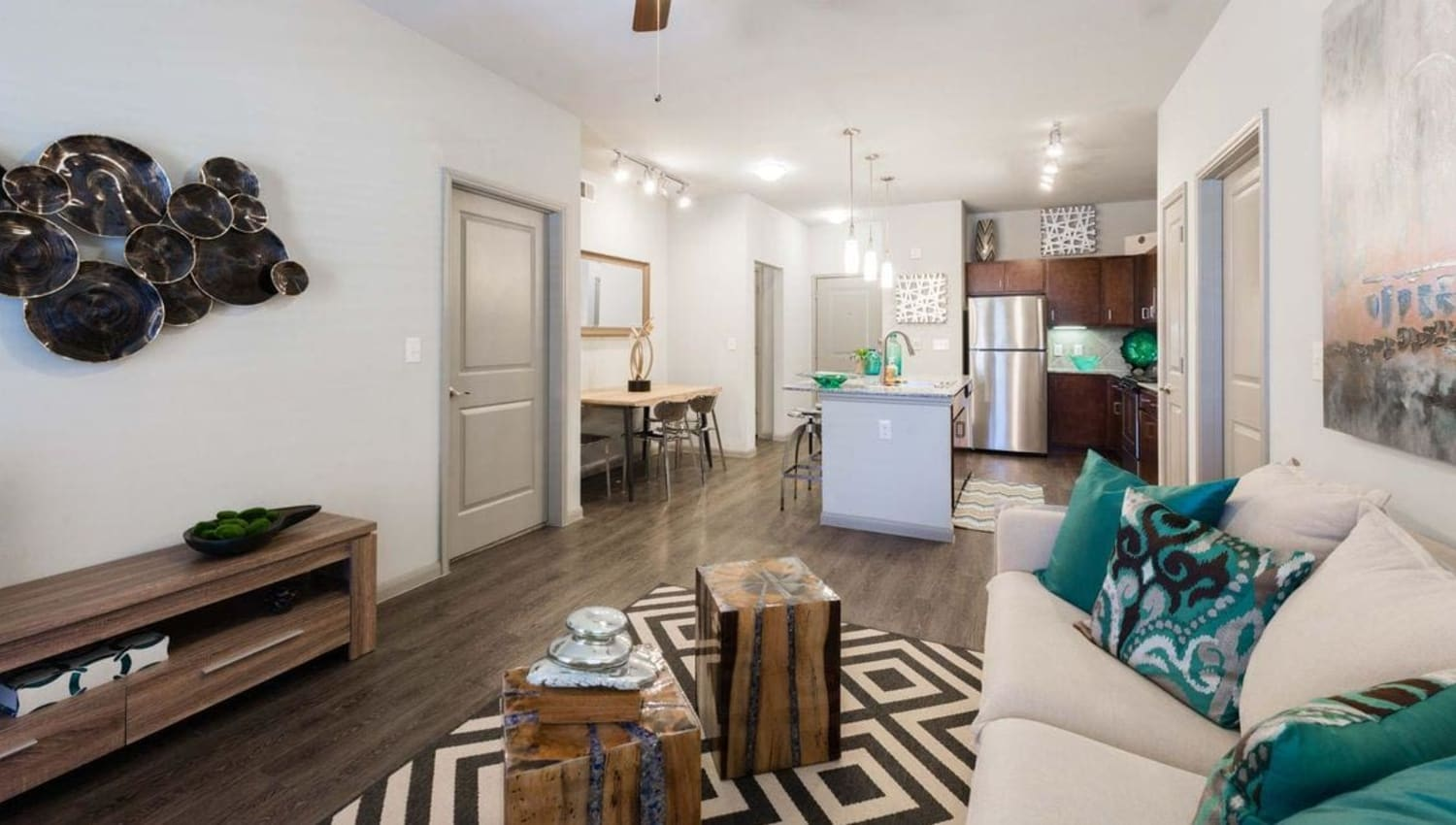 Model apartment living room at Olympus at Waterside Estates in Richmond, Texas
