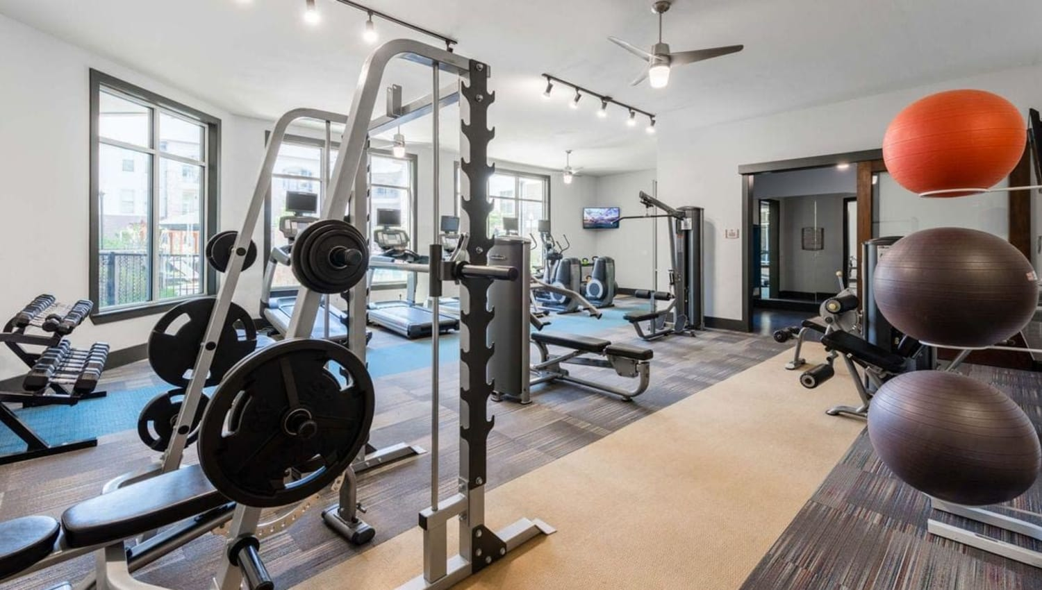 Full-sized fitness facility at Olympus at Waterside Estates in Richmond, Texas