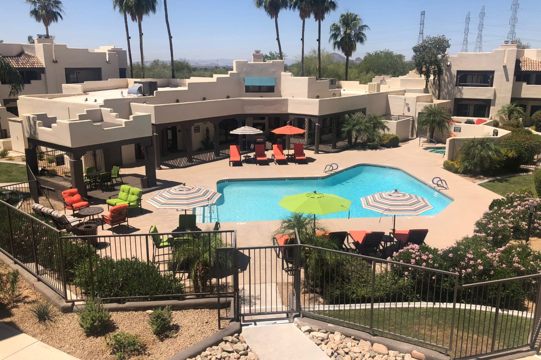 Aerial view of the swimming pool at Casa Santa Fe Apartments in Scottsdale, Arizona