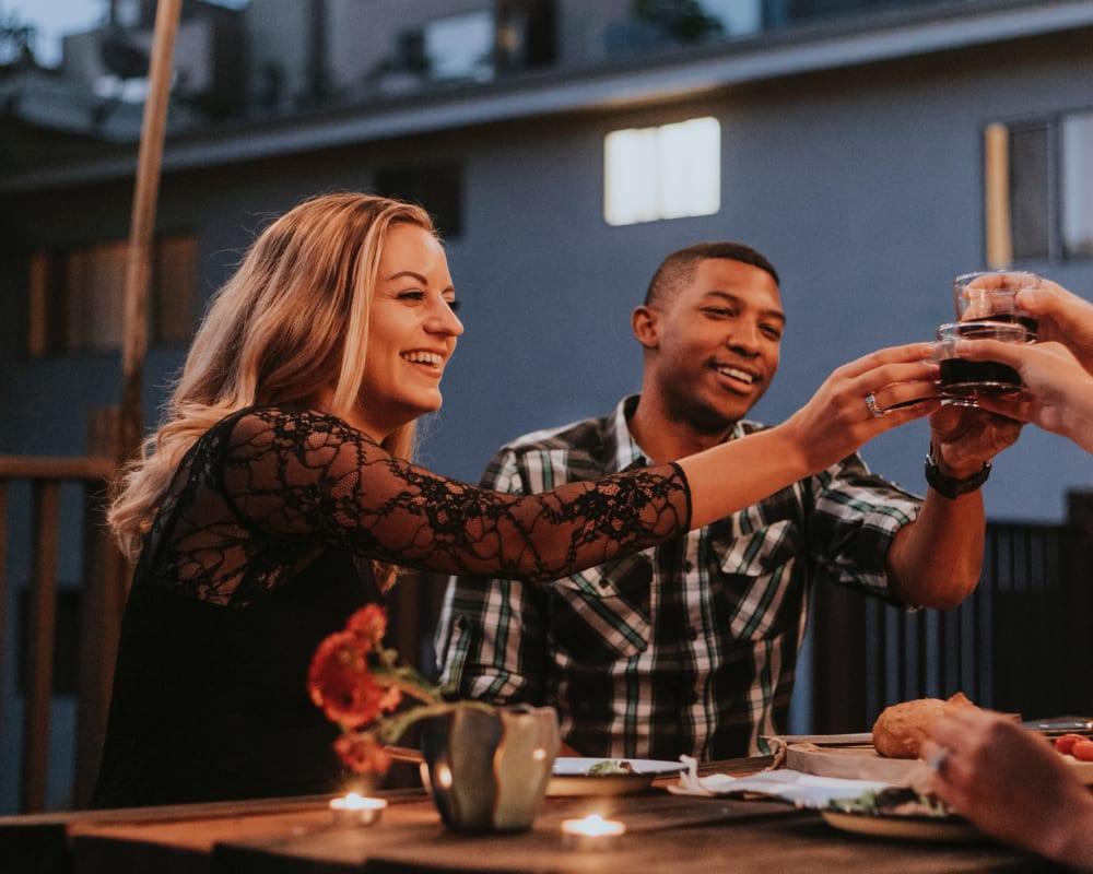 Resident friends raising a toast to the good life at Velō in Boston, Massachusetts