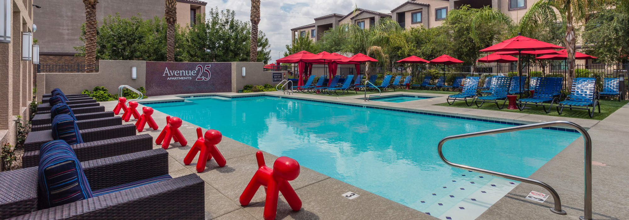 Beautiful resort-style pool with patio seating at Avenue 25 Apartments in Phoenix, Arizona
