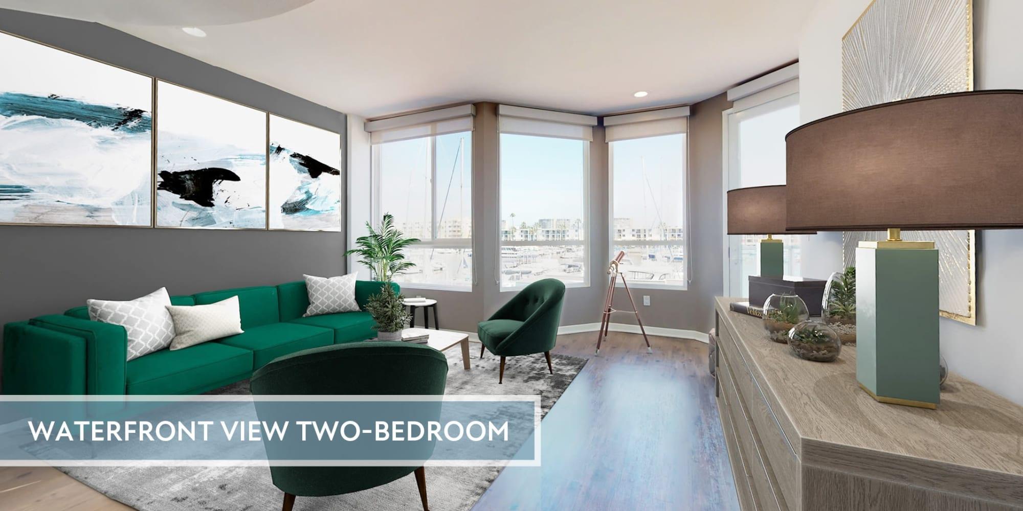 Spacious  apartment's living room with views of the marina and hardwood floors at Esprit Marina del Rey in Marina del Rey, California