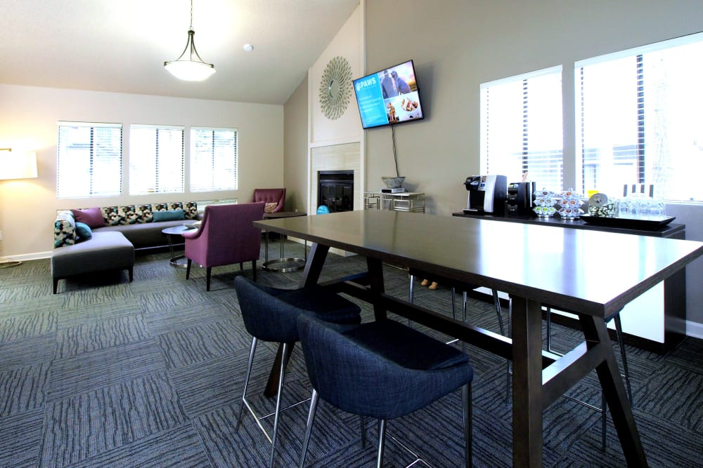 Resident clubhouse with lots of windows for natural lighting at Plum Tree Apartment Homes in Martinez, California