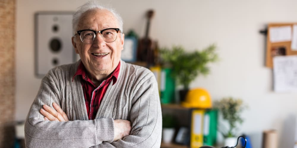 A resident smiling from getting Red Carpet Service at Harmony Place in Harmony, Minnesota.