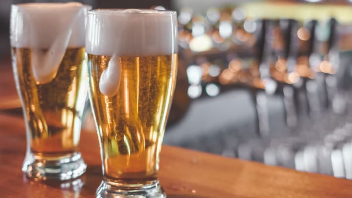 Happy hour beers at a bar near Olympus Las Colinas in Irving, Texas