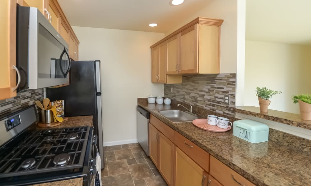 Kitchen at Hill Brook Place Apartments in Bensalem, Pennsylvania