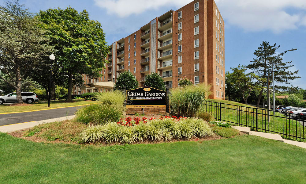 Entrance monument at Cedar Gardens and Towers Apartments & Townhomes in Windsor Mill, MD