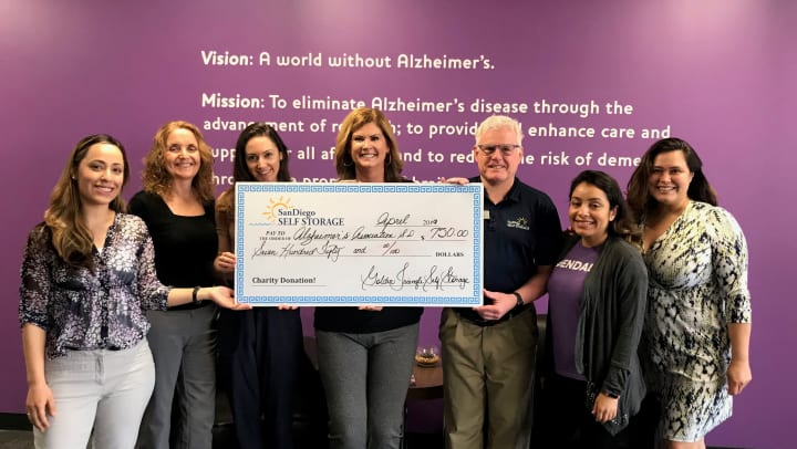 Golden Triangle Self Storage presenting check to The Alzheimer's Association