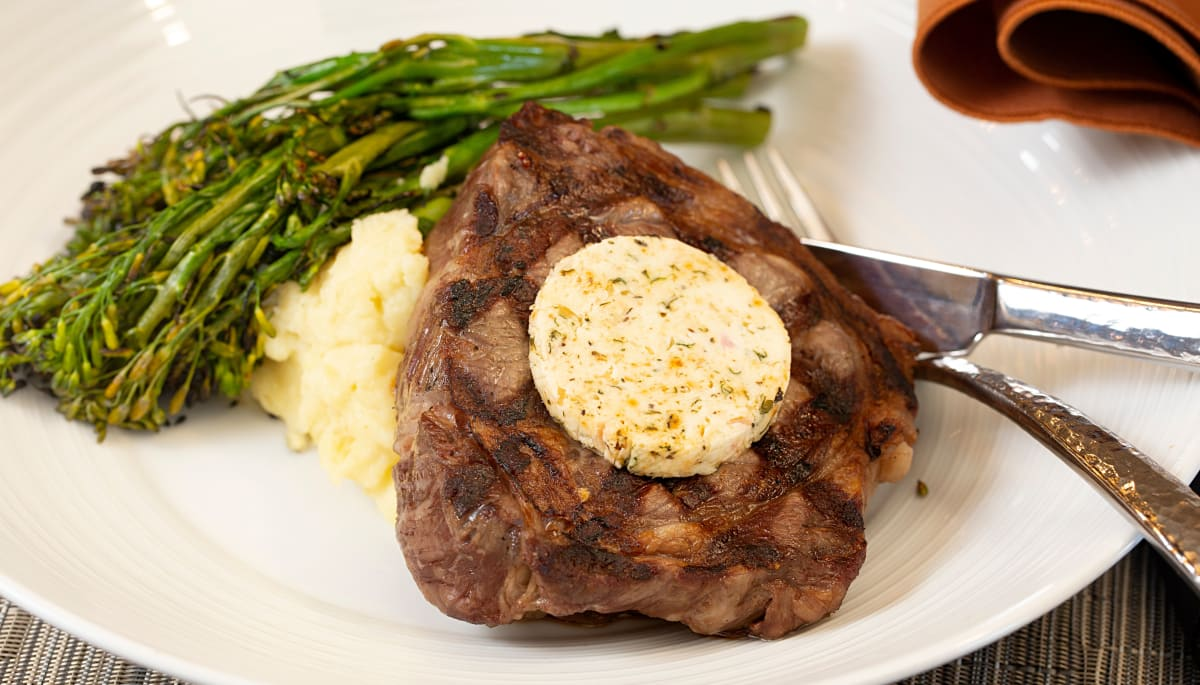 A steak with a side of asparagus and mashed potatoes at Touchmark at Wedgewood in Edmonton, Alberta