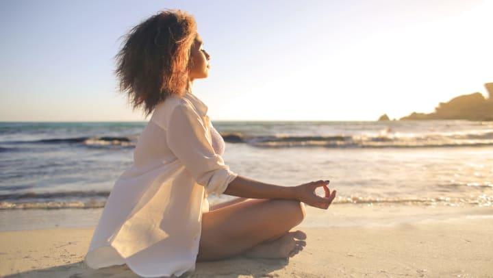 Resident in a restful yoga position on a beach near Olympus Fenwick in Savannah, Georgia