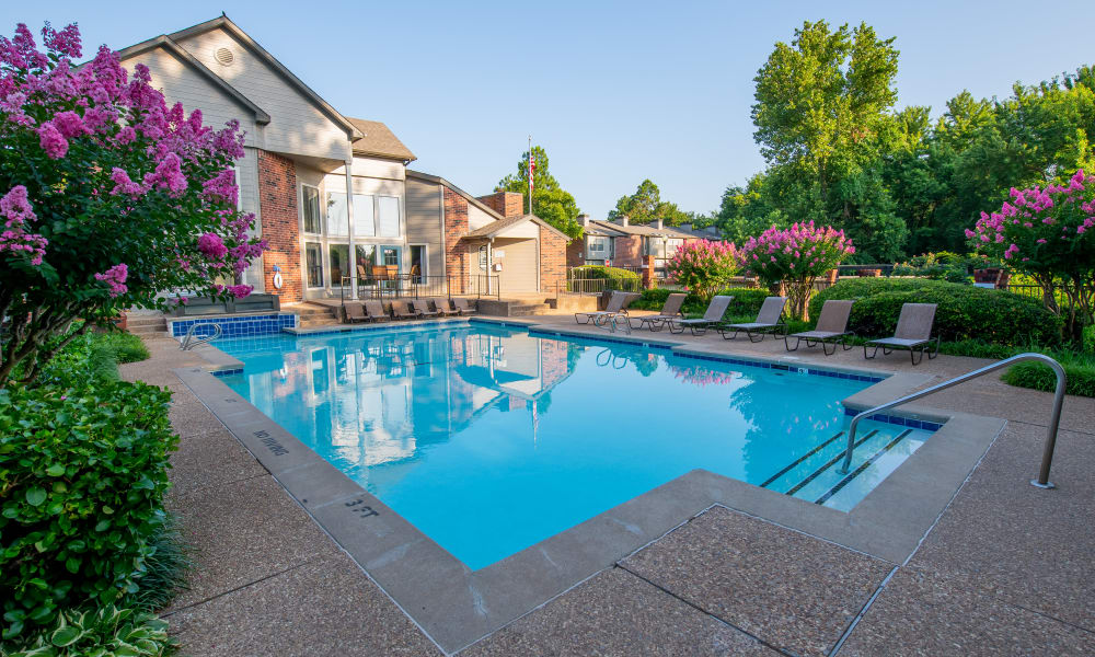 Sparkling pool with lounge chairs at Creekwood Apartments in Tulsa, Oklahoma