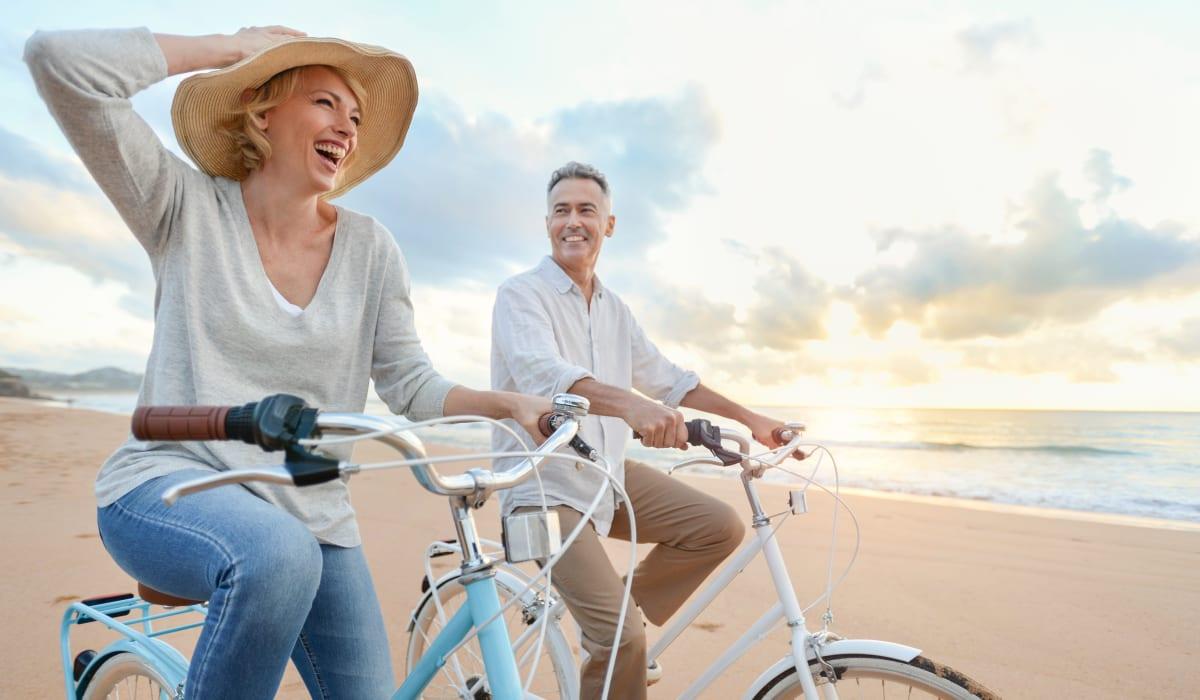 Riding bikes on the beach near The Pointe at Siena Ridge in Davenport, Florida