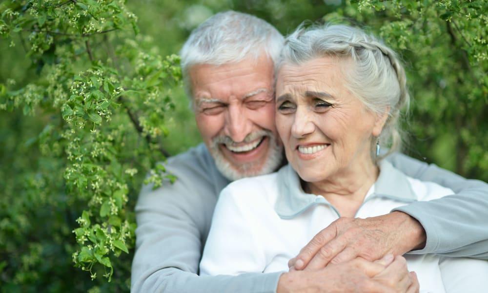 Resident couple hugging at Blossom Vale Senior Living in Orangevale, California