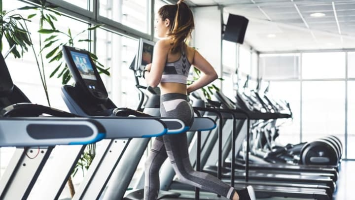 Woman running on treadmill in a gym near {{location_name}} in {{location_city}}, {{location_state_name}}.