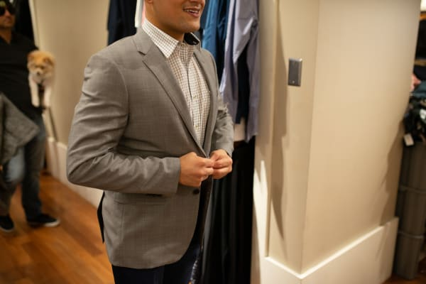 Resident downtown trying on suits near ArLo in Phoenix, Arizona
