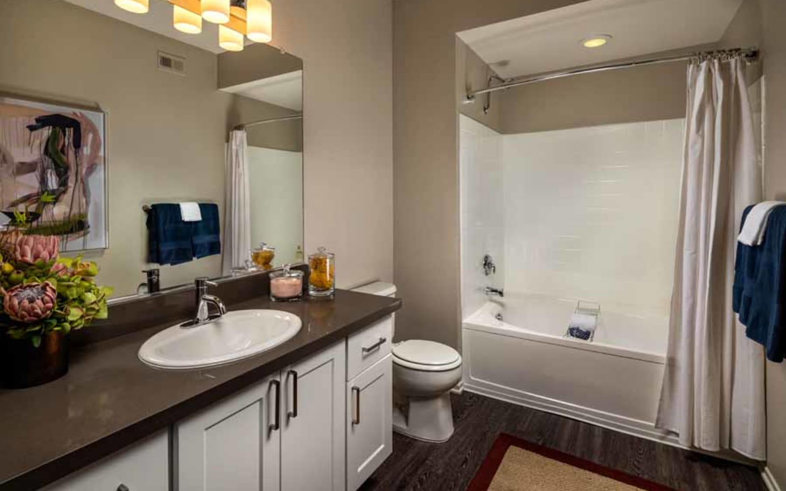 A decorated apartment bathroom at Castlerock at Sycamore Highlands in Riverside, California