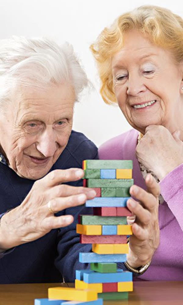 Senior couple playing jenga at The Phoenix at Greer in Greer, South Carolina
