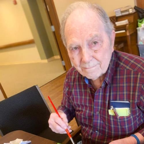 Resident painting at Oxford Glen Memory Care at Sachse in Sachse, Texas