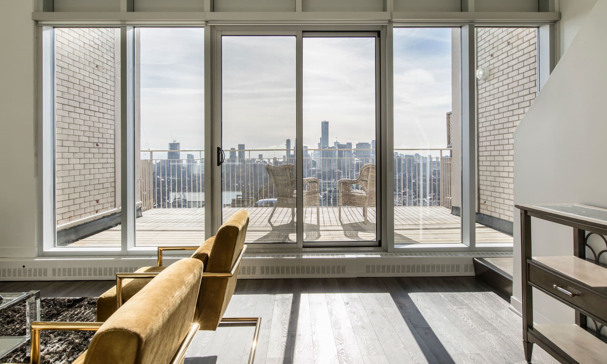 Large panoramic window in one of the penthouses at Bretton Place in Toronto