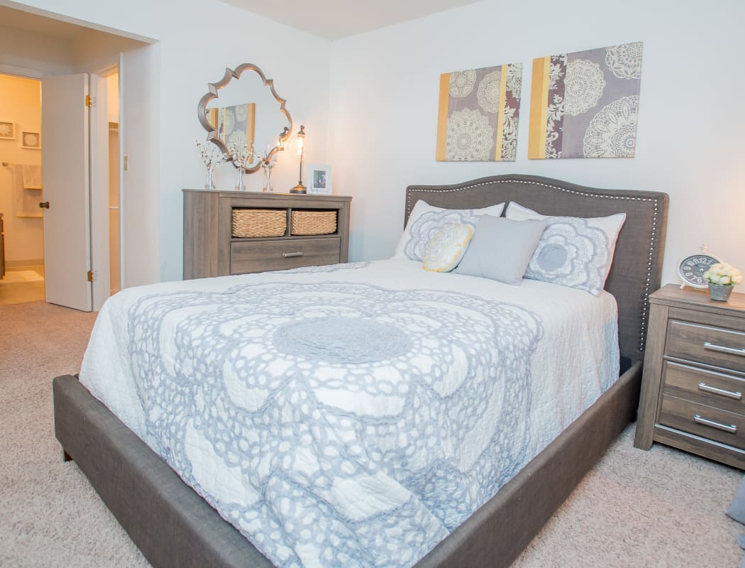 Master bedroom with en suite bathroom in model home at The Greens of Bedford in Tulsa, Oklahoma