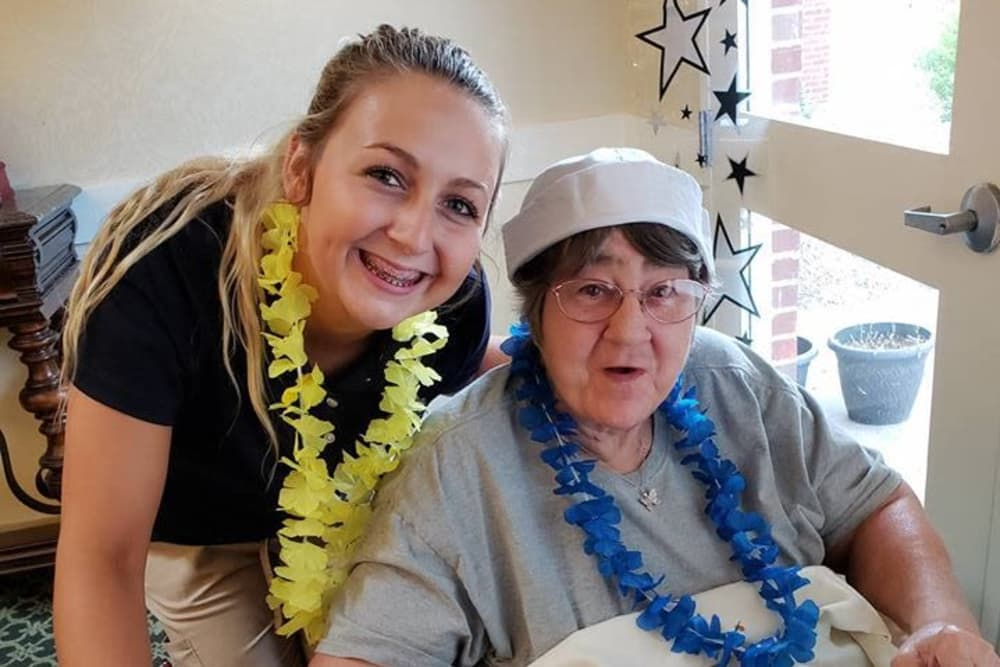 A resident and caretaker at Woodmont Health Campus in Boonville, Indiana