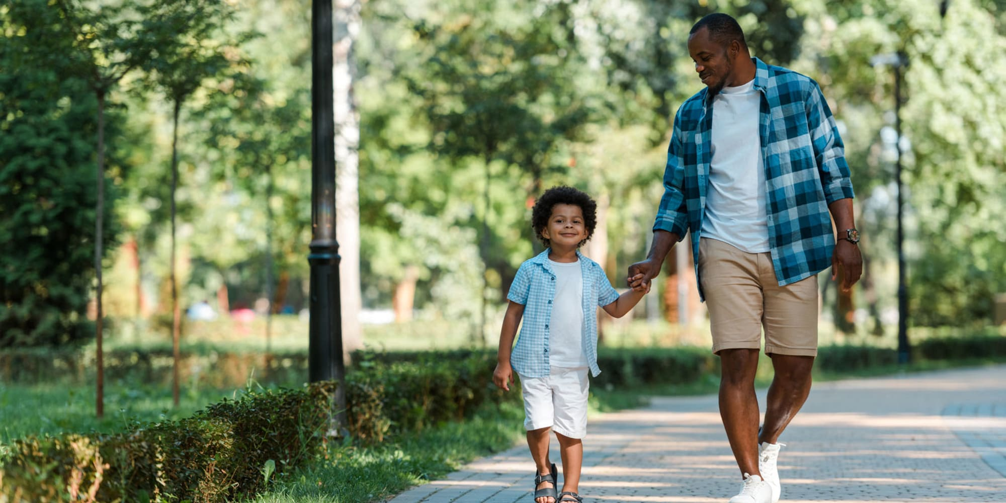 Father walking his son to school near Pleasanton Glen Apartment Homes in Pleasanton, California