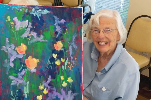 A resident painting at Cedarview Gracious Retirement Living in Woodstock, Ontario
