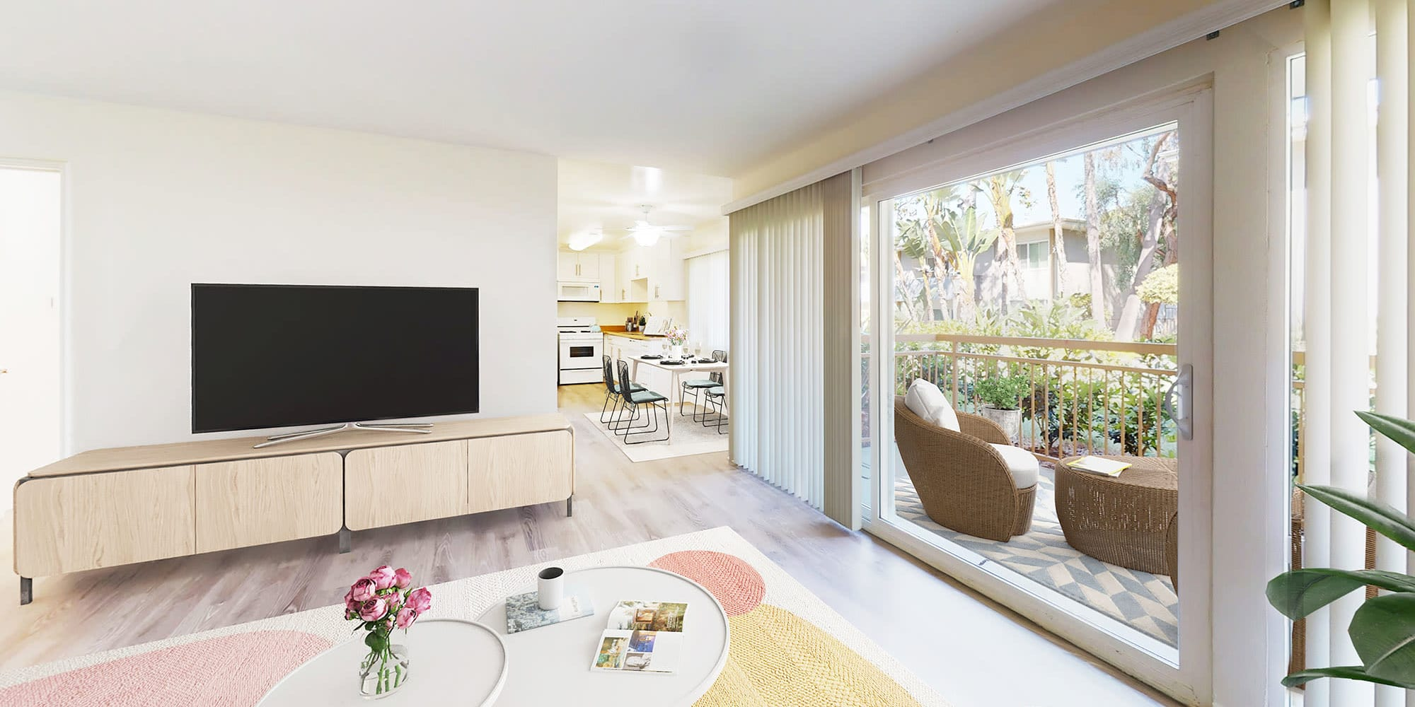 Floor-to-ceiling windows and a sliding door leading to a model two bedroom home's private balcony at