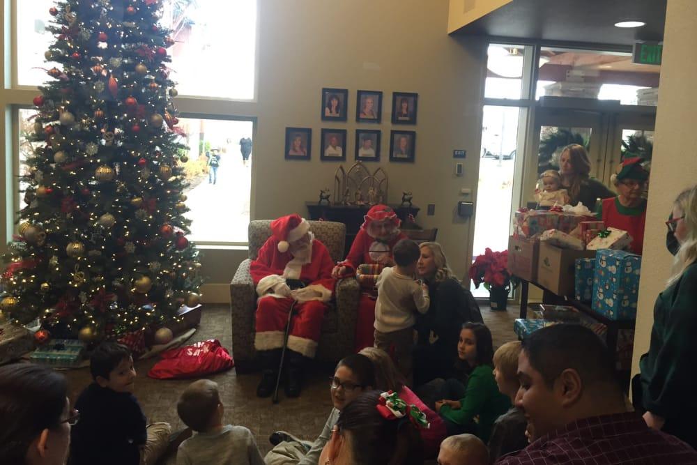 senior residents dressed as Mr & Mrs. Santa Claus