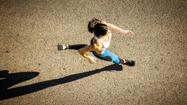 Woman running on pavement