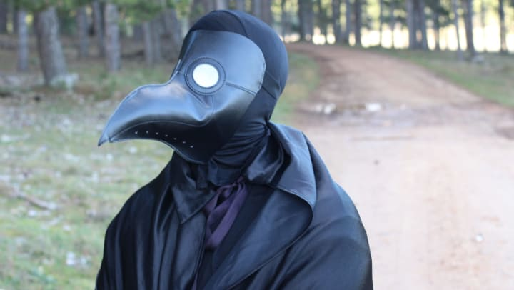 Plague doctor mask for blog post for Olympus on Main in Carrollton, Texas