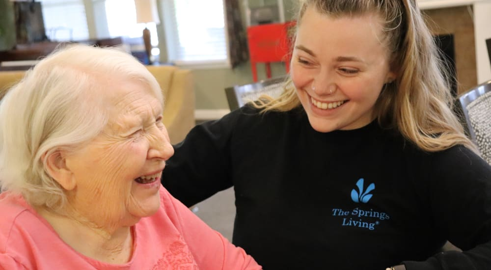 Resident with caregiver at The Springs at Clackamas Woods in Milwaukie, Oregon
