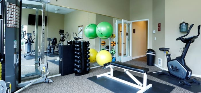 Our on-site fitness center makes staying fit easy at Discovery Landing Apartment Homes in Burien, WA