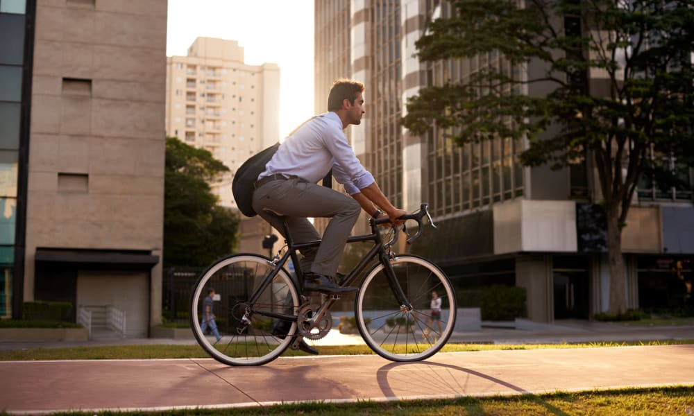 Resident biking to work at his downtown office near Oaks Hackberry Creek in Irving, Texas