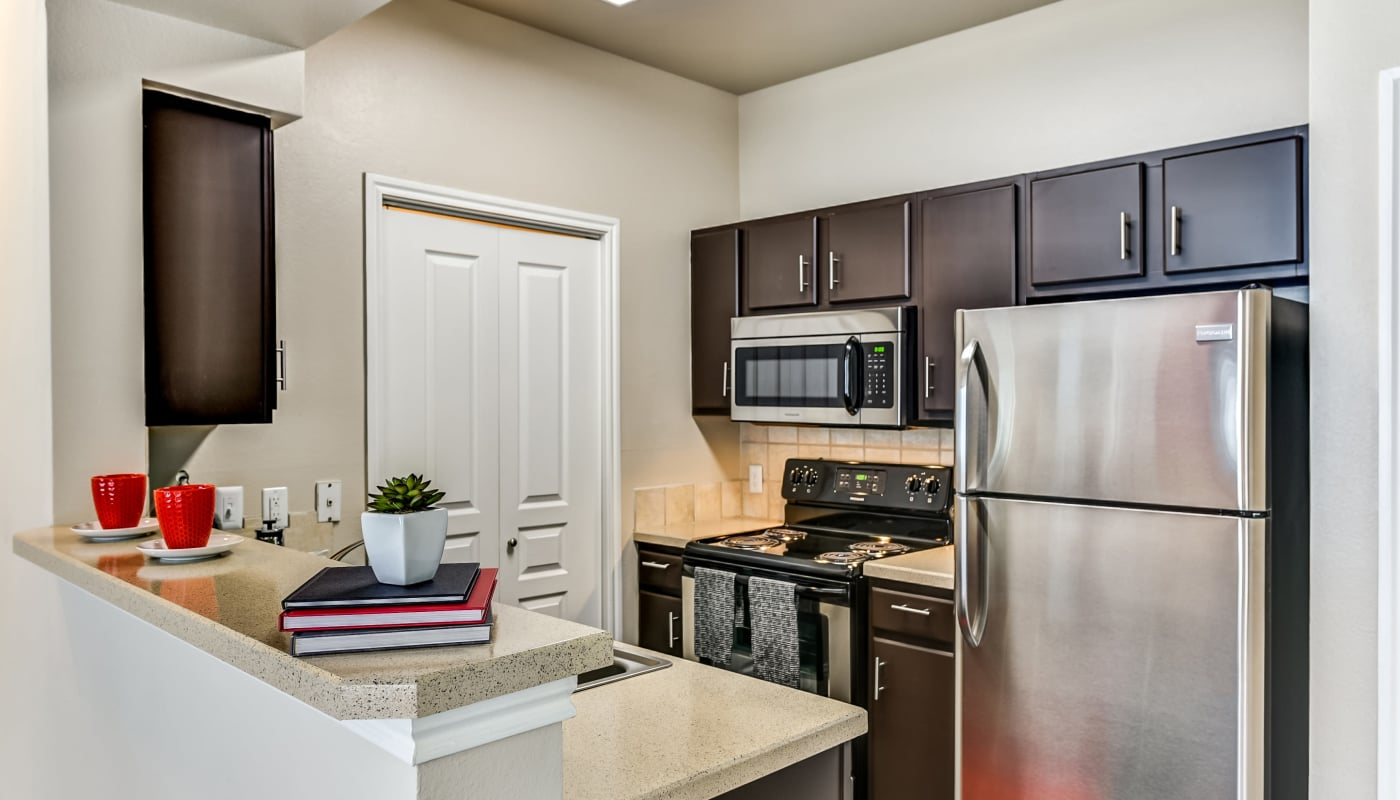 Upgraded kitchen at Abbey at Vista Ridge Apartments