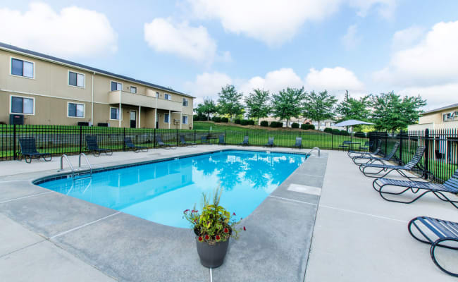 Large swimming pool with a sundeck at Wexford Apartment Homes in Charlotte, North Carolina