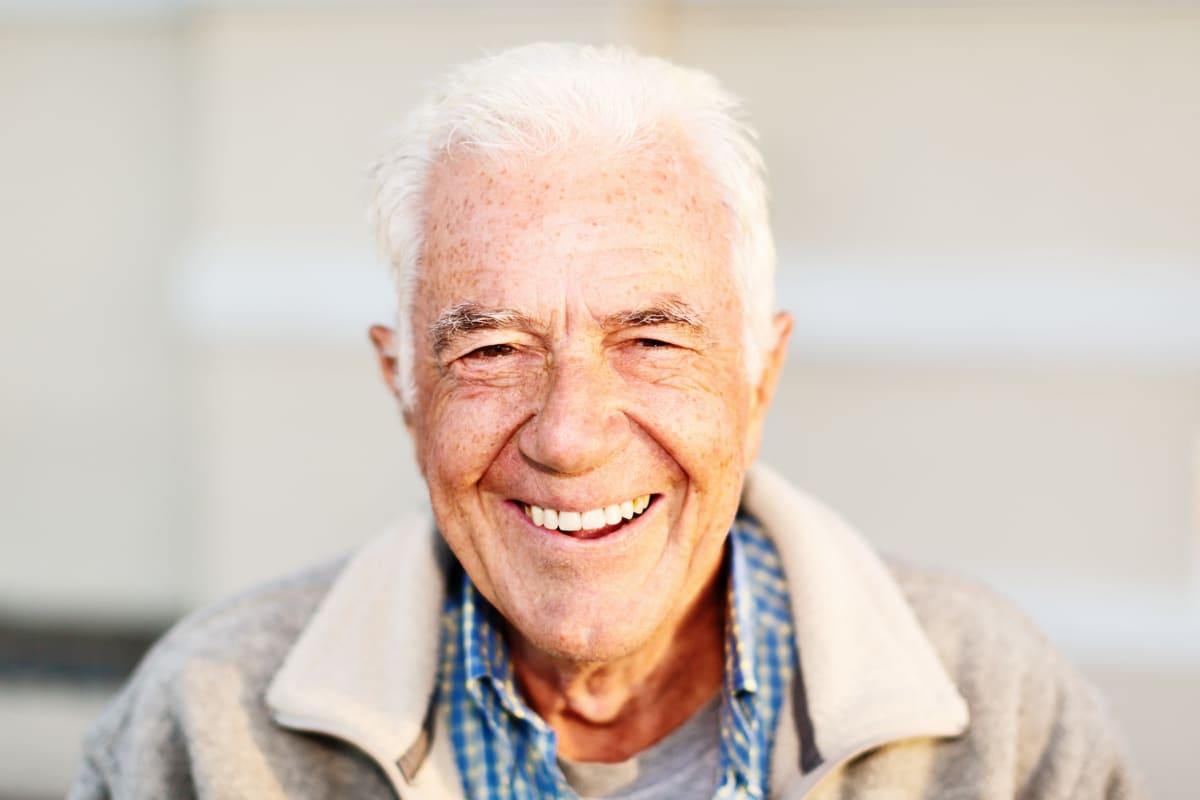 Resident smiling into the camera at Estancia Senior Living in Fallbrook, California