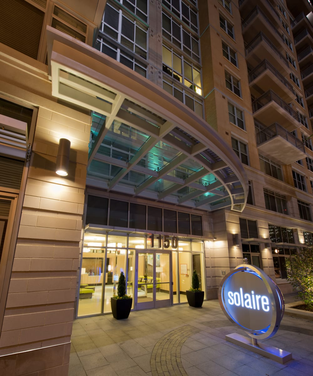 Beautiful street view of the entrance at dusk of Solaire 1150 Ripley in Silver Spring, Maryland