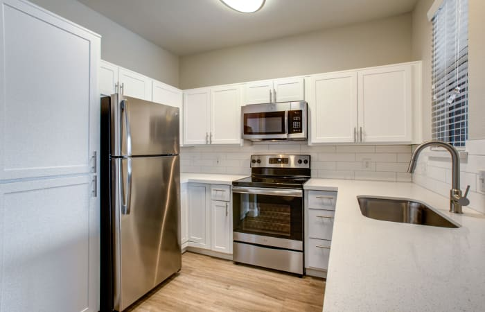 Recently renovated kitchen with stainless-steel appliances in an apartment home at Sierra Canyon in Glendale, Arizona