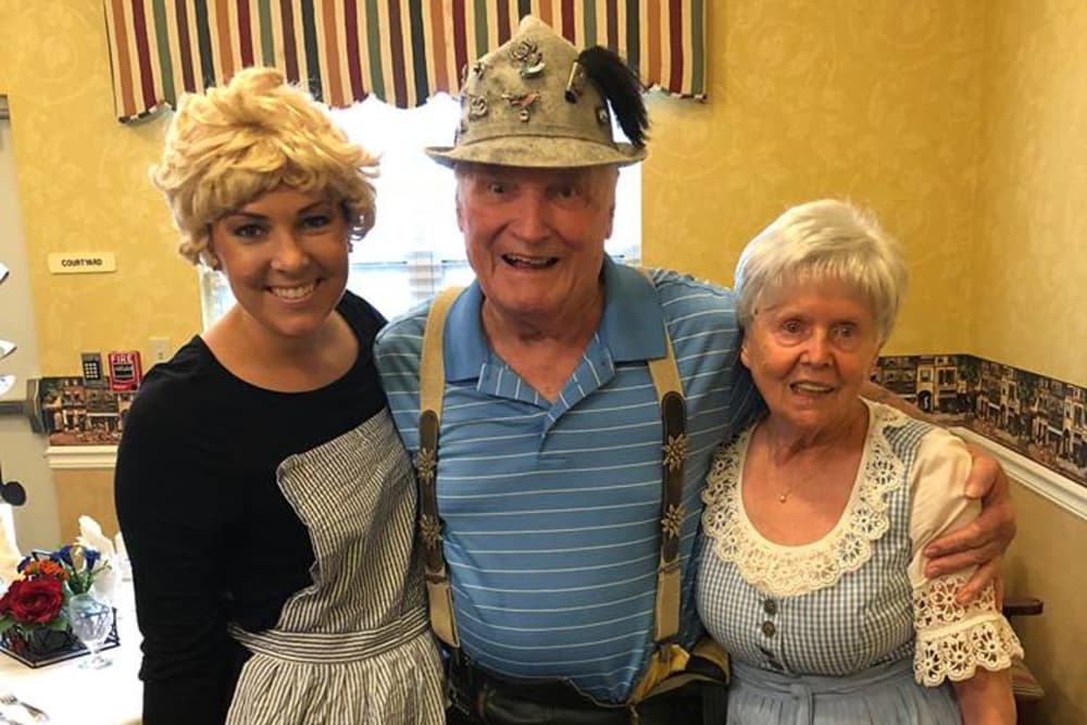 A caretaker and residents dressed up at Westport Place Health Campus in Louisville, Kentucky