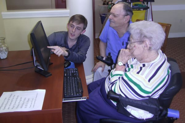 Residents being trained on how to use a computer at Traditions of Hershey in Palmyra, Pennsylvania
