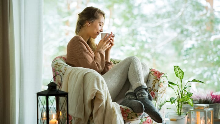 Woman sitting in chair with cup of tea