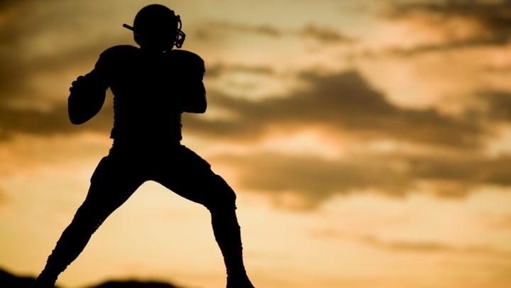 Silhouette of football quarterback