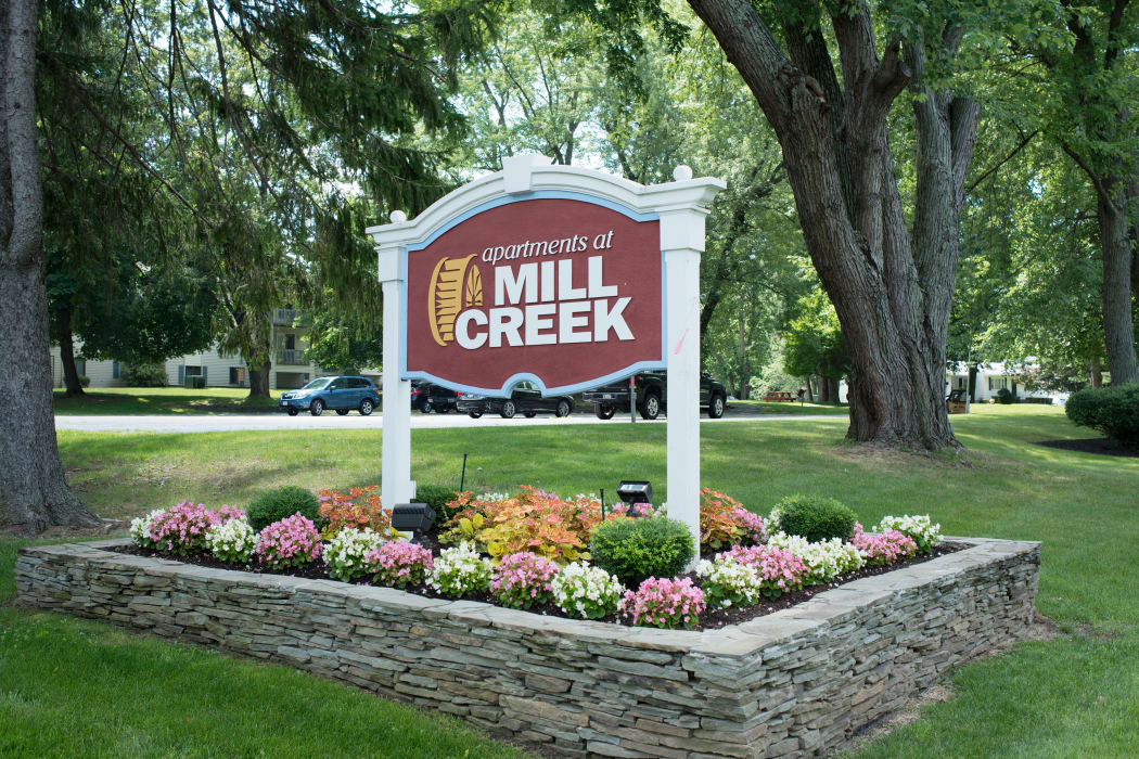 Entrance Sign at Mill Creek Apartments in East Greenbush