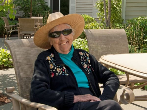 A resident enjoying a nice day outside at Patriots Glen in Bellevue, Washington.