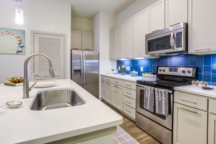 Stainless-steel appliances in a model home's kitchen at Agave in San Antonio, Texas