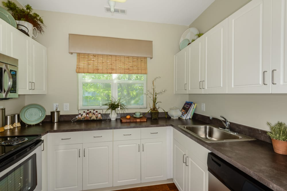 Kitchen with white cabinets at Sofi Danvers in Danvers, MA