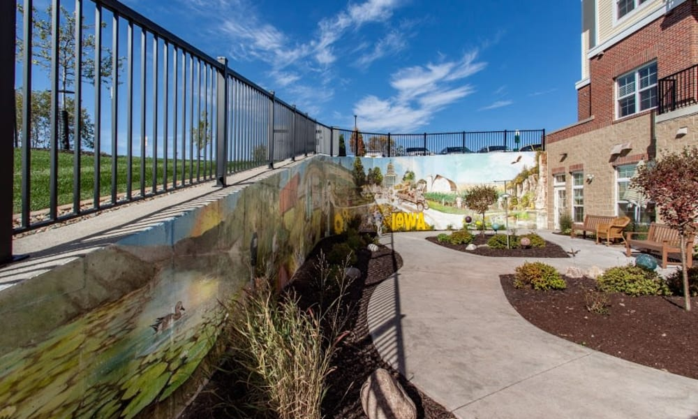 An outdoor mural in the memory care courtyard at Keystone Place at Forevergreen in North Liberty, Iowa