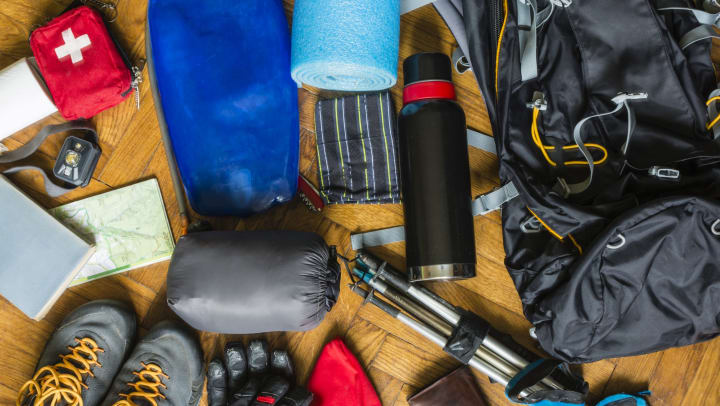 Camping gear arranged on the floor