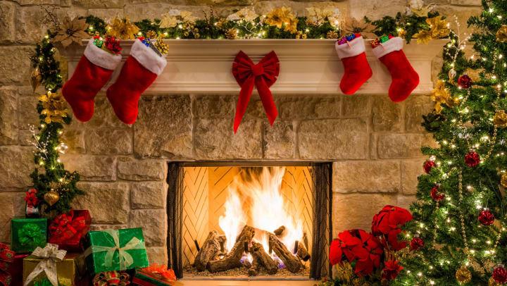 Beautiful Christmas decorations surrounding a fireplace